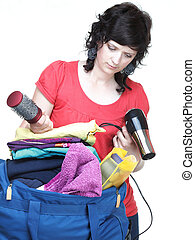 woman hand crammed full of clothes and shoulder bag isolated