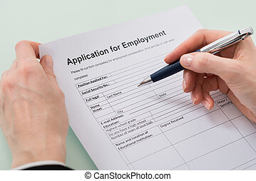 Woman Hand Filling Employment Form