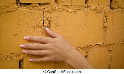 Woman hand gently stroke surface, slide on stony wall of old...