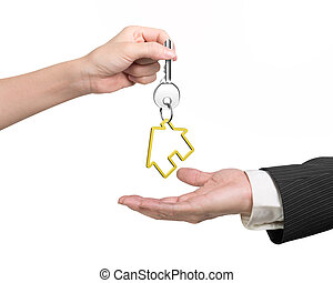 Woman hand giving key with house keyring to man hand - Woman...