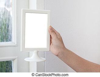 woman hand holding a blank menu frame