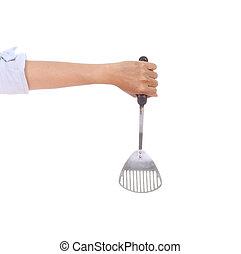 woman hand holding a kitchen spatula