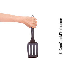 woman hand holding a kitchen spatula isolated on white...