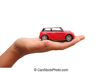 woman hand holding a toy car. business concept