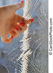 Woman hand holding an odd shaped piece of ice