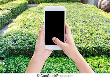 Woman hand holding cellphone watching video