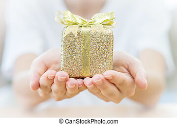 Woman hand holding gift box.
