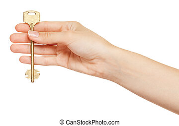 Woman hand holding gold key isolated on white background