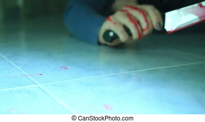 Female murder victim trying to reach a blade