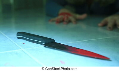 Woman hand holding knife with blood - Female murder victim...
