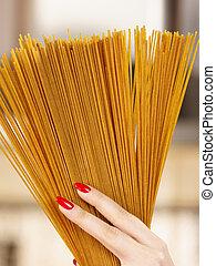 Woman hand holding pasta