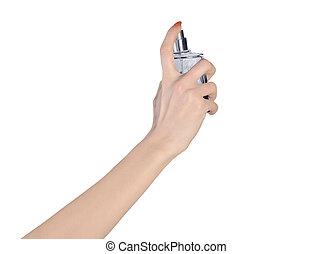 Woman hand holding perfume