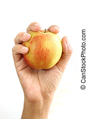 Woman hand holding red apple.
