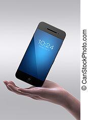 Woman hand holding smart phone