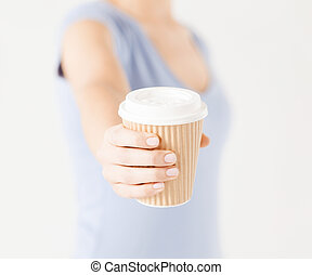 woman hand holding take away coffee cup - close up of woman...