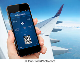 woman hand holding the phone with mobile wallet and plane...