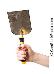 Woman hand holding trowel