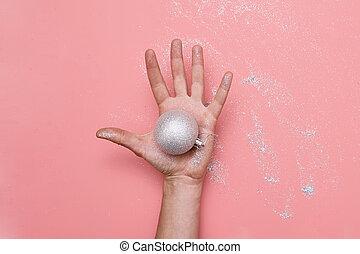 Woman hand in glitter. Hand made christmas tree balls. Diy craft. Holiday season
