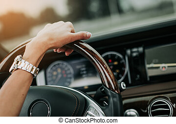 Woman hand keeping tool for driving car