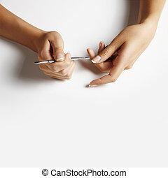 woman hand making manicure