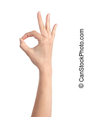 Woman hand making ok gesture isolated on a white background...