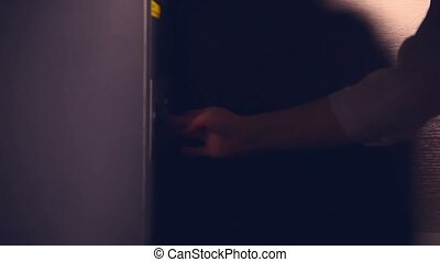 woman hand opens safe checks documents and closes the...