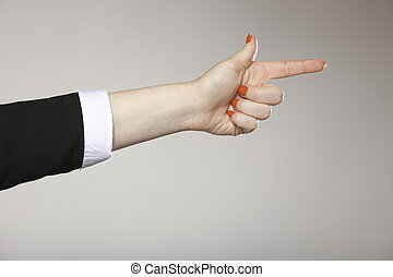 Woman hand pointing direction with index finger