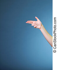 Woman hand pointing direction with finger
