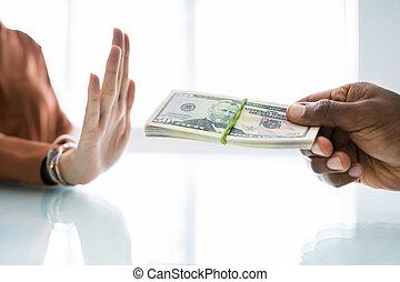 Hand Refusing Bribe