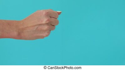 Woman hand show rock paper scissors game blue background