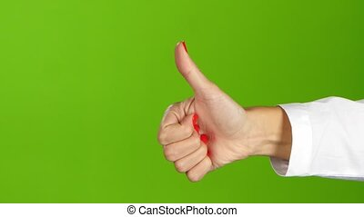 Woman hand, sign language. Thumb up and then thumb down -...