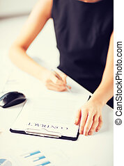 woman hand signing contract paper - picture of woman...