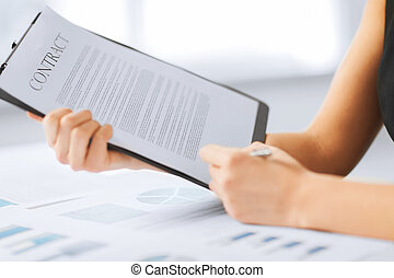 woman hand signing contract paper - business, office, law...