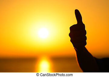 Woman hand silhouette gesturing thumb up