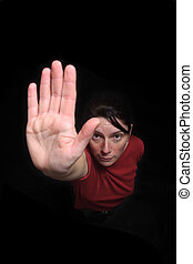 woman hand stop sign on black background