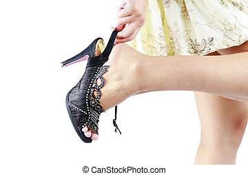 woman hand touching her foot in High heels shoes.