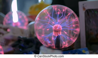 Woman hand touching plasma ball at technology exhibition....