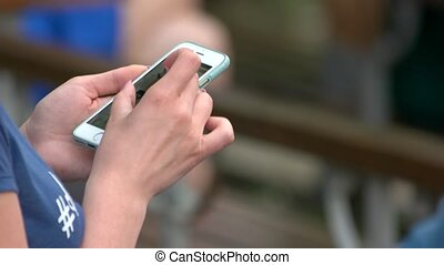 Woman hand touching screen on modern mobile smart phone.