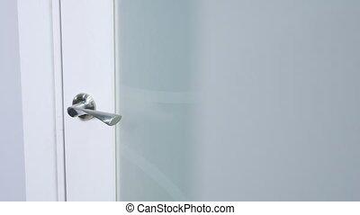 woman hand white door handle close-up - white Door handle...