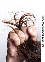 Woman hand with damaged hair
