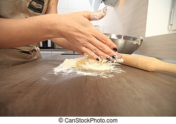 Woman hand with dough