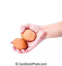 Woman hand with eggs isolated on white background
