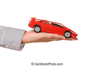 Woman hand with holding red sports car - isolated on white
