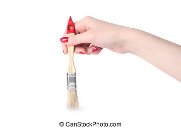 Woman hand with paintbrush
