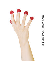 Woman hand with raspberries.