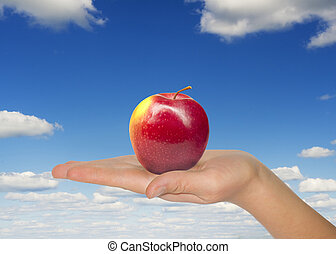 Woman hand with red apple