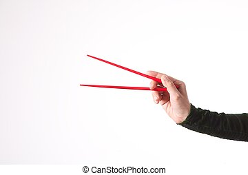woman hand with red chopsticks