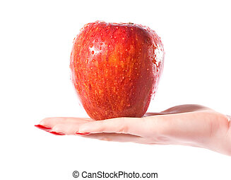 Woman hand with wet red apple