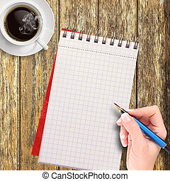 Woman hand writing in a notepad