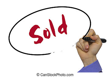 Woman Hand Writing Sold on blank transparent board with a marker isolated over white background. Business concept.
